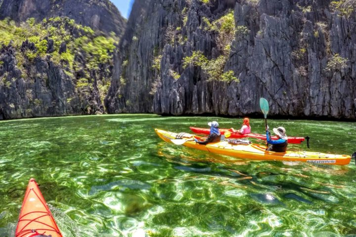 Headed for a tiny gap in the rocks to explore one of the hidden lagoons around Coron Island.