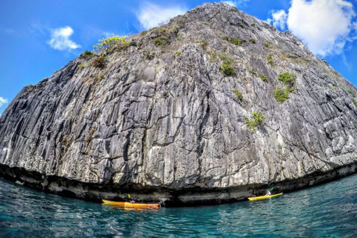 Paddling the enormous undercut cliffs off the south coast of Coron Island.