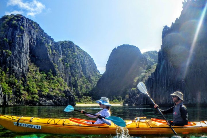 Paddling the cliff coastline of Coron island