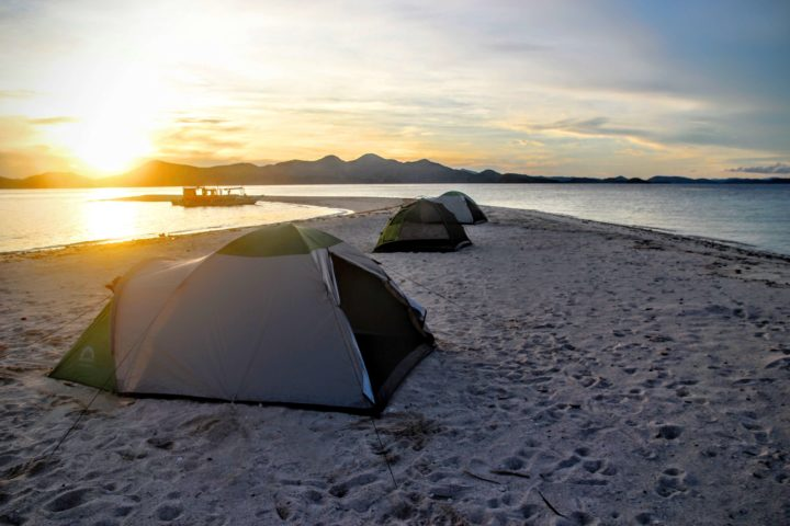 Camping and sunset view on the sandbar of Ditaytayan Iisland.